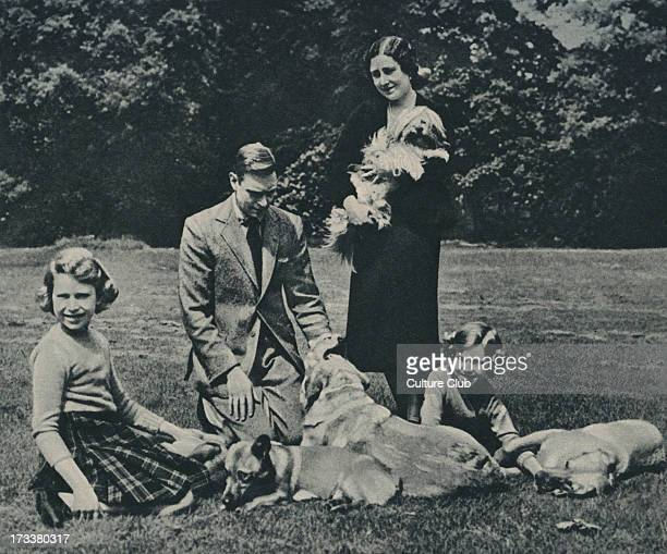 George VI with Queen Consort Elizabeth and Princesses Elizabeth and Margaret with Tibetan Lion dog labradors and corgis c 1937 Royal Lodge Windsor