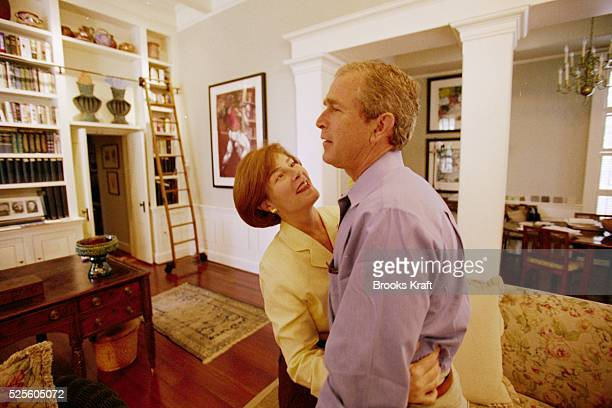 George W Bush and his wife Laura share a hug while at the Governor's Mansion in Austin Texas Governor of Texas since 1994 Bush was granted the United...