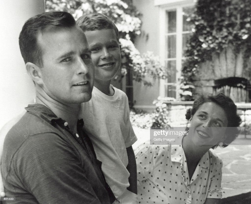 George W Bush poses with father George Bush and his mother Barbara Bush in Rye New York summer 1955 George W Bush is currently campaigning for the...