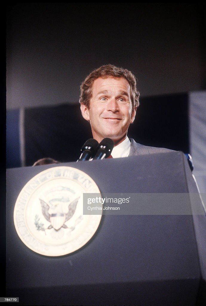 <a gi-track='captionPersonalityLinkClicked' href=/galleries/search?phrase=George+W.+Bush&family=editorial&specificpeople=122011 ng-click='$event.stopPropagation()'>George W. Bush</a> speaks in support of his father Vice President George Bush on the campaign trail August 26, 1988 in the USA. Vice President Bush and his running mate Dan Quayle defeat Michael Dukakis in the Presidential election. His efforts to reduce the deficit failed while creating the lowest growth period since the Great Depression.