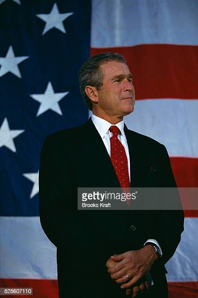 George W Bush stands before the American flag while on a presidential campaign stop in Iowa Bush won the 2000 Presidential Election against Vice...