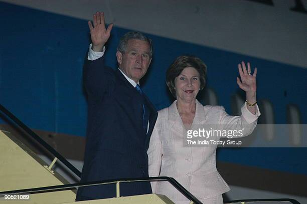 George W Bush United States President with his wife Laura Bush at the airport for their departure in New Delhi India