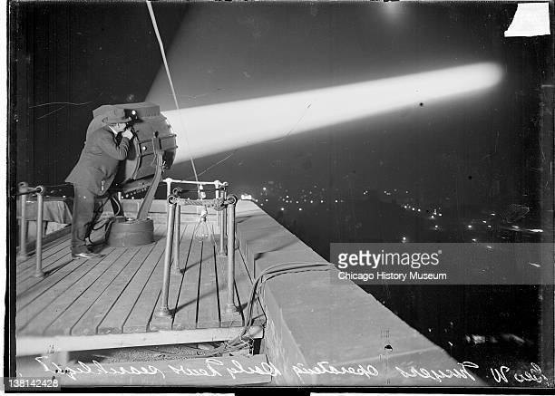 George W Meyers operating the Chicago Daily News searchlight at night Chicago Illinois 1916 From the Chicago Daily News collection