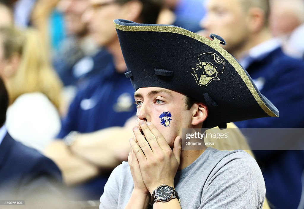 A George Washington Colonials fan reacts during their 71 to 66 loss to the Memphis Tigers during the Second Round of the 2014 NCAA Basketball Tournament at PNC Arena on March 21, 2014 in Raleigh, North Carolina.