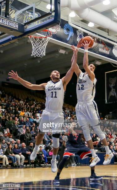 George Washington Colonials forward Arnaldo Toro and guard Yuta Watanabe team up to get the ball during a men's college basketball game between the...