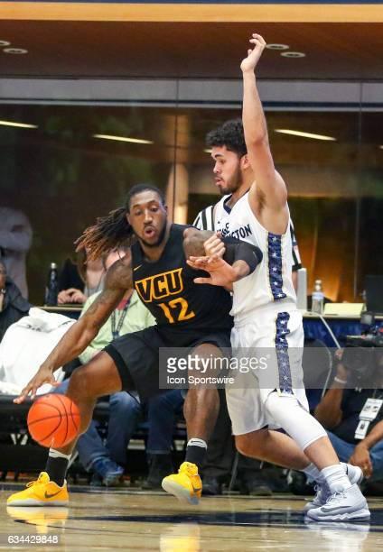 George Washington Colonials forward Arnaldo Toro blocks Virginia Commonwealth Rams forward Mo AlieCox during an Atlantic 10 men's basketball game on...