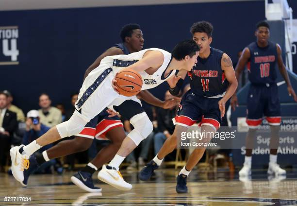 George Washington Colonials guard Yuta Watanabe dribbles by Howard Bison guard Kyle Foster during a men's college basketball game between the George...
