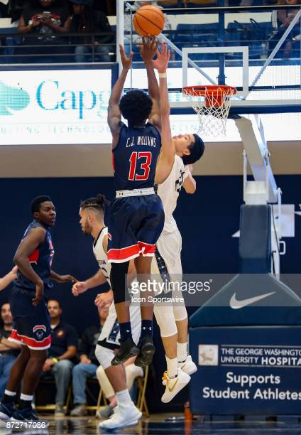 George Washington Colonials guard Yuta Watanabe reaches up to block a shot by Howard Bison forward Charles Williams during a men's college basketball...