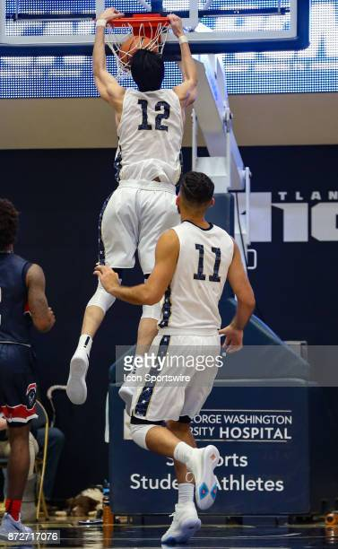 George Washington Colonials guard Yuta Watanabe slam dunks during a men's college basketball game between the George Washington Colonials and the...