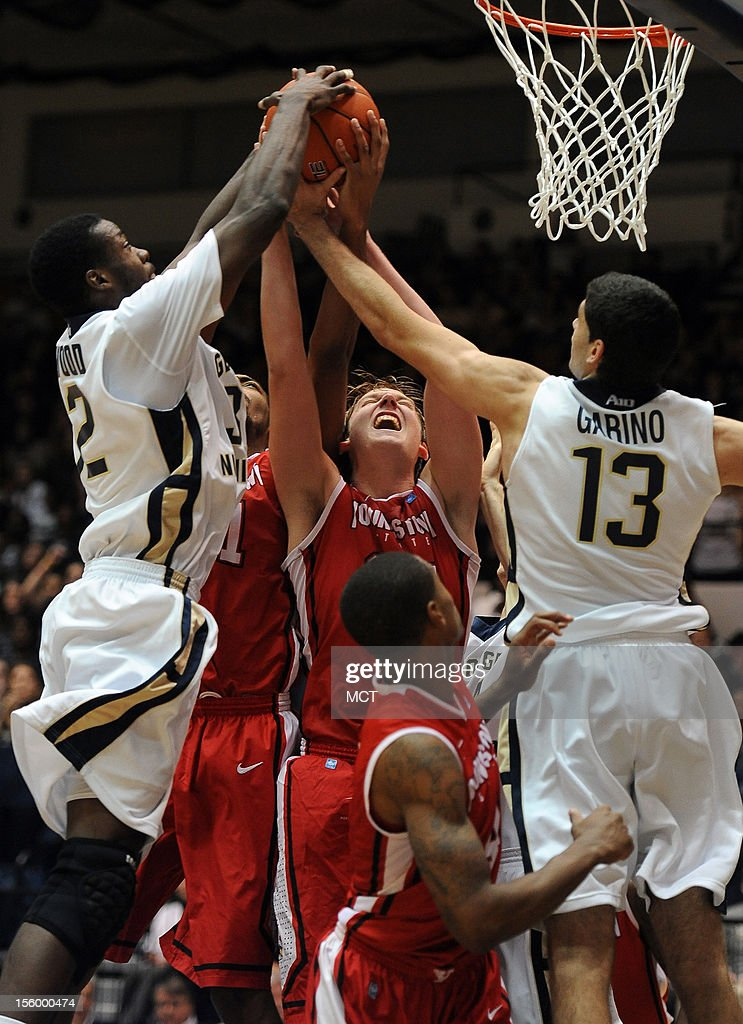 George Washington forward Isaiah Armwood (32), left, George Washington forward Patricio Garino (13), Youngstown State forward Bobby Hain (20), center, and Youngstown State forward Damian Eargle (21), back left, battle for a rebound in the second half at the Smith Center in Washington, D.C., Saturday, November 10, 2012. Youngstown State defeated GWU, 80-73.