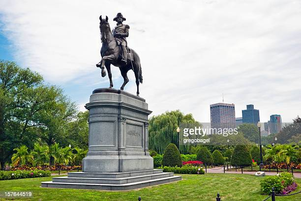 George Washington statue with office buildings in background