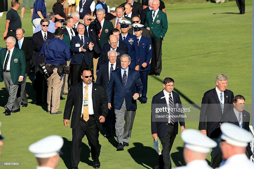 George W.Bush past President of the United States leads in the official party as a preview for the 2013 Walker Cup Match at National Golf Links of America on September 6, 2013 in Southampton, New York.