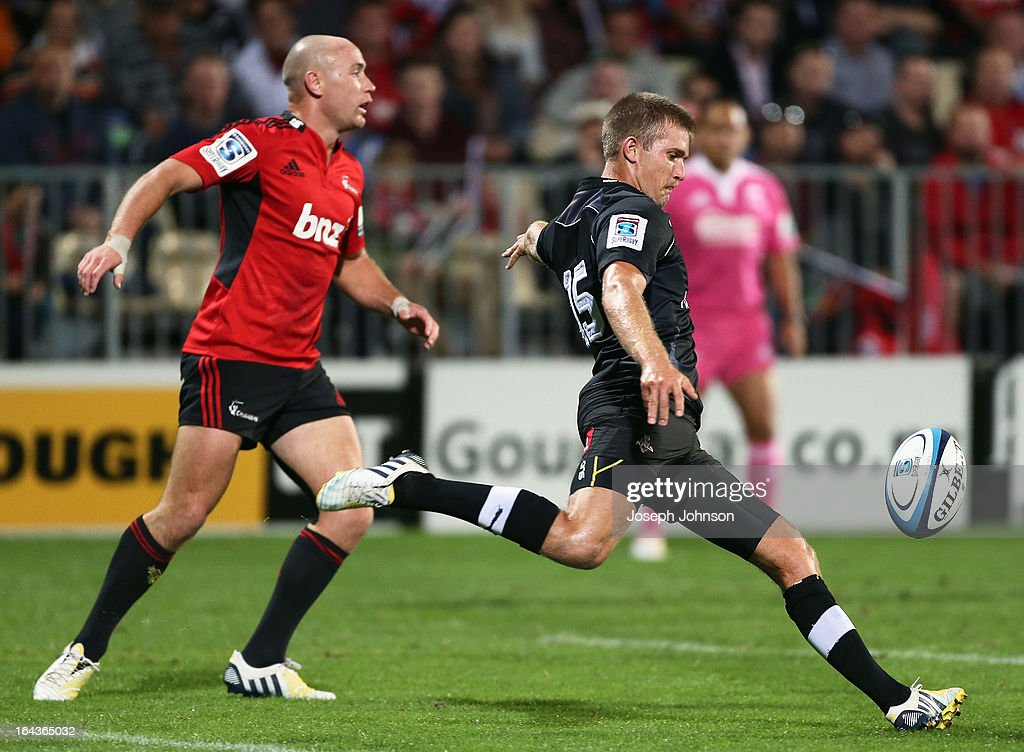 George Whitehead of the Kings kicks the ball with Willie Heinz of the Crusaders during the round six Super Rugby match between the Crusaders and the Kings at AMI Stadium on March 23, 2013 in Christchurch, New Zealand.