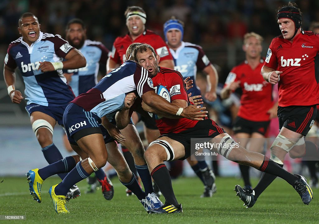 <a gi-track='captionPersonalityLinkClicked' href=/galleries/search?phrase=George+Whitelock&family=editorial&specificpeople=4532140 ng-click='$event.stopPropagation()'>George Whitelock</a> of the Crusaders is tackled during the round 3 Super Rugby match between the Blues and the Crusaders at Eden Park on March 1, 2013 in Auckland, New Zealand.