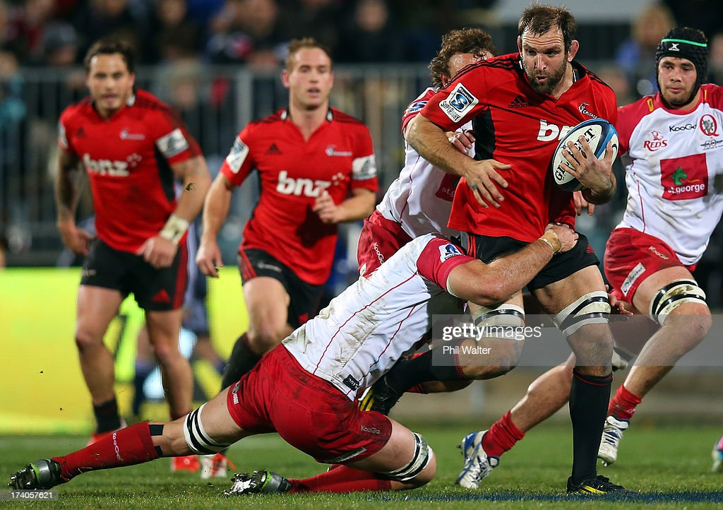 <a gi-track='captionPersonalityLinkClicked' href=/galleries/search?phrase=George+Whitelock&family=editorial&specificpeople=4532140 ng-click='$event.stopPropagation()'>George Whitelock</a> of the Crusaders is tackled during the Super Rugby Qualifying Final match between the Crusaders and the Reds at AMI Stadium on July 20, 2013 in Christchurch, New Zealand.