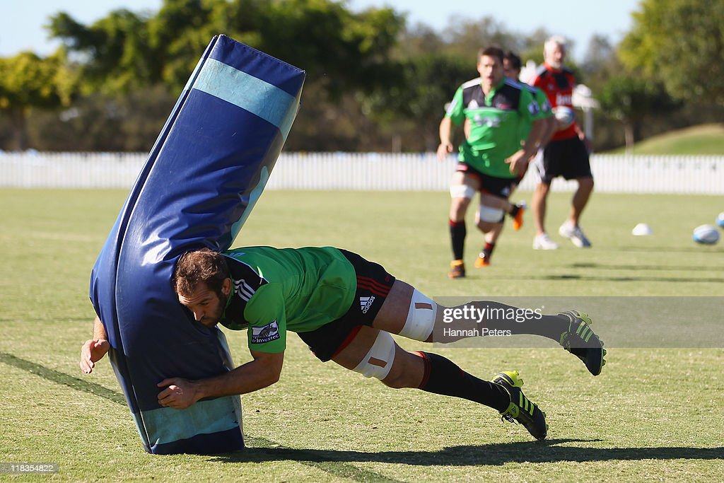 <a gi-track='captionPersonalityLinkClicked' href=/galleries/search?phrase=George+Whitelock&family=editorial&specificpeople=4532140 ng-click='$event.stopPropagation()'>George Whitelock</a> runs through drills during a Crusaders Super Rugby training session at Brisbane Grammar School on July 7, 2011 in Brisbane, Australia.