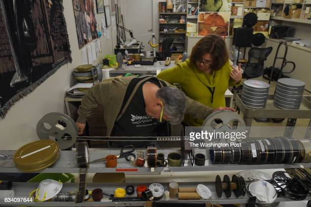 George Willeman the Nitrate Film Vault Manager at the Library of Congress and Lynnanne Schweighofer a preservation specialist look through one of the...