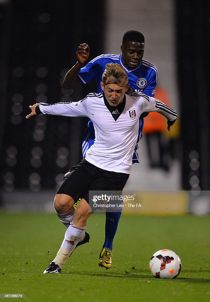 George Williams of Fulham battles with Ola Aina of Chelsea during the FA Youth Cup Final First Leg match between Fulham U18 and Chelsea U18 at Craven Cottage on April 28, 2014 in London, England.