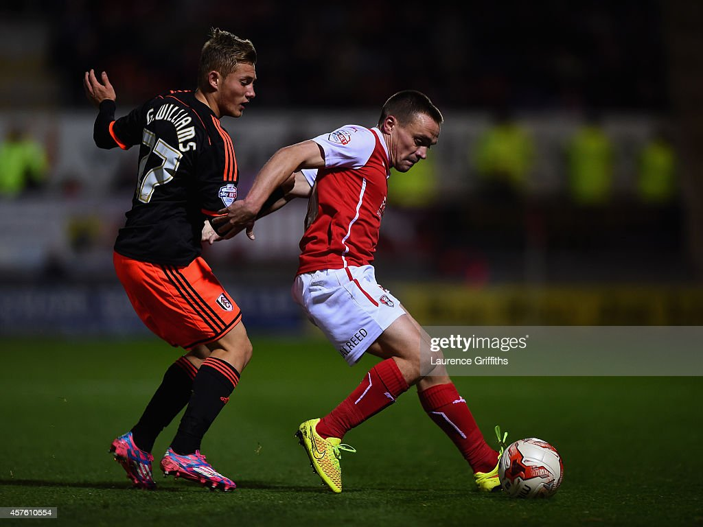 George Williams of Fulham battles with Paul Taylor of Rotherham during the Sky bet Championship match between Rotherham United and Fulham at The New York Stadium on October 21, 2014 in Rotherham, England.