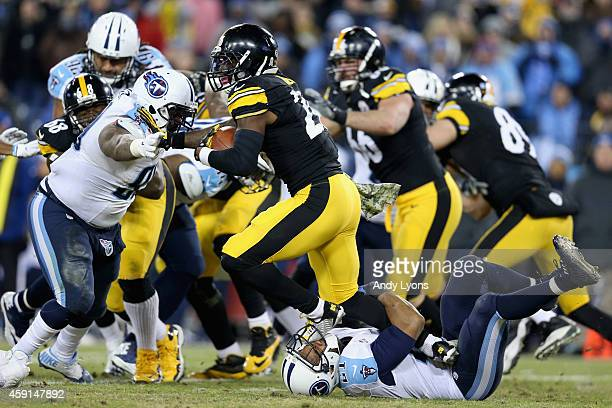 George Wilson of the Tennessee Titans is stepped on as he attempts to tackle Le'Veon Bell of the Pittsburgh Steelers in the second quarter at LP...
