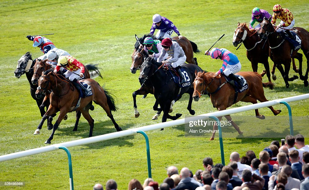 George Wood riding Knight Owl (3L, yellow cap) win The championsofracing.co.uk Suffolk Stakes at Newmarket racecourse on April 30, 2016 in Newmarket, England.