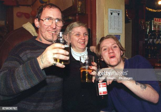 George Woods celebrates his 800000 win in yesterday's lottery draw with wife Debbie Baker and stepson Darren Whittaker The win was his part of an 82...