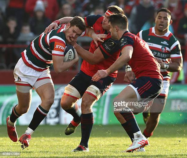 George Worth of Leicester is tackled by CJ Stander and Conor Murray during the European Champions Cup match between Munster and Leicester Tigers at...