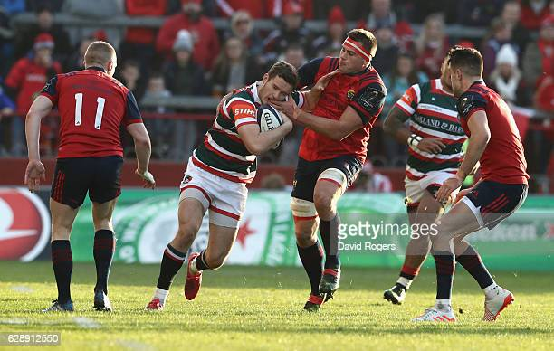 George Worth of Leicester is tackled by CJ Stander during the European Champions Cup match between Munster and Leicester Tigers at Thomond Park on...