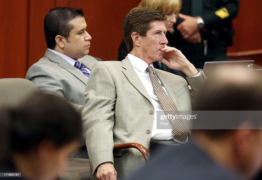 George Zimmerman (L) and Defense attorney Mark O'Mara listen to Don West's questioning of witness Rachel Jeantel during Zimmerman's murder trial in Seminole circuit court June 27, 2013 in Sanford, Florida. Zimmerman is charged with second-degree murder for the February 2012 shooting death of 17-year-old Trayvon Martin.