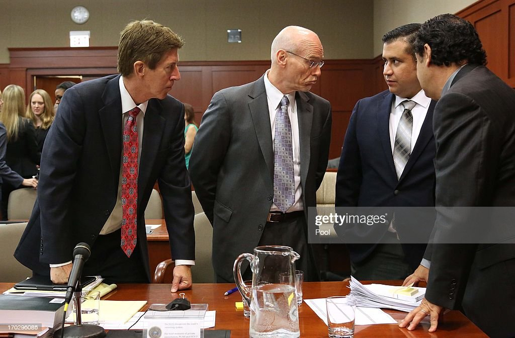 George Zimmerman (2R) and his attorneys discuss jury questionnaires with defense attorney Mark O'Mara (left) co-counsel Don West (2L), and jury consultant Robert Hirschhorn (far right), on the first day of his trial in Seminole circuit court June 10, 2013 in Sanford, Florida. Jury selection will begin today as Zimmerman is charged with the second-degree murder of an unarmed teenager, Trayvon Martin.