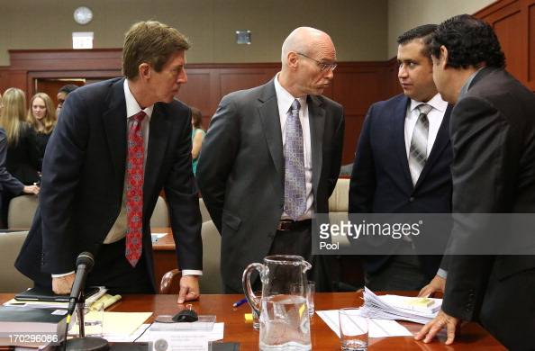 George Zimmerman and his attorneys discuss jury questionnaires with defense attorney Mark O'Mara cocounsel Don West and jury consultant Robert...