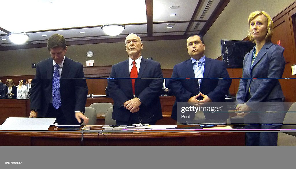 George Zimmerman (2nd from right) appears with his attorneys in Seminole circuit court (L-R) Mark O'Mara, Don West, and Lorna Truett on February 5, 2013 in Sanford, Florida. A judge denied the request to delay Zimmerman's trial for the death of Trayvon Martin. It is scheduled for June 10.