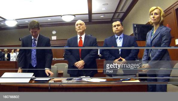 George Zimmerman appears with his attorneys in Seminole circuit court Mark O'Mara Don West and Lorna Truett on February 5 2013 in Sanford Florida A...