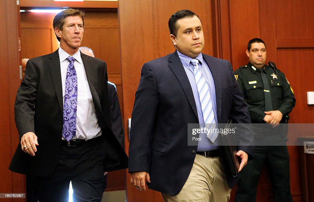 George Zimmerman arrives with his lead counsel Mark O'Mara for a hearing in Seminole circuit court February 5 2013 in Sanford Florida A judge denied...