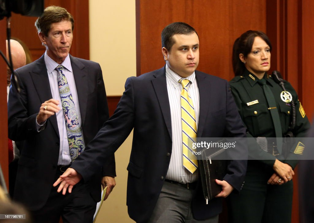 George Zimmerman, defendant in the killing of Trayvon Martin, arrives in Seminole circuit court with his attorney Mark O'Mara (L) for a pre-trial hearing April 30, 2013 in Sanford, Florida. Lawyers on both sides of the Trayvon Martin murder trial are jockeying for position as the trail is expected to start June 10. The defense seeks to add witnesses, but declines to identify them as the prosecution accuses them of grandstanding.