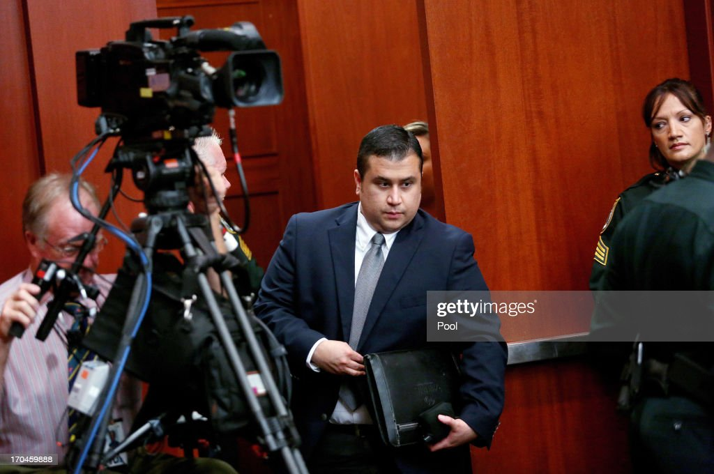 George Zimmerman enters the courtroom after a recess in Seminole circuit court on fourth day of his murder trial June 13, 2013 in Sanford, Florida. Jury selection continues in Zimmerman's second-degree murder trial for the shooting death of the unarmed teenager Trayvon Martin.