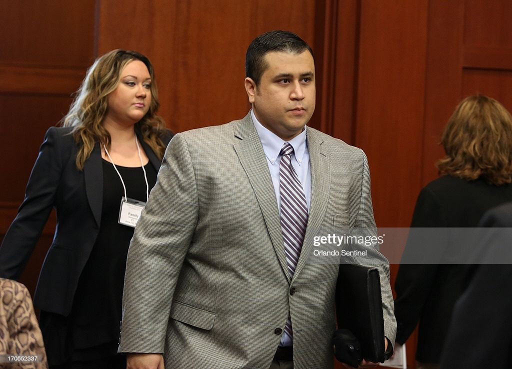 George Zimmerman enters the courtroom, followed by his wife Shelly, on the fifth day of jury selection for his trial in Seminole circuit court in Sanford Florida, Friday, June 14, 2013. Zimmerman has been charged with second-degree murder for the 2012 shooting death of Trayvon Martin.