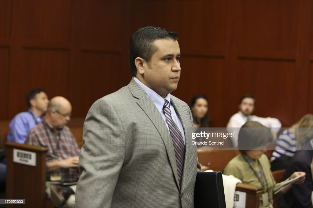 George Zimmerman enters the courtroom on the fifth day of jury selection for his trial in Seminole circuit court in Sanford Florida, Friday, June 14, 2013. Zimmerman has been charged with second-degree murder for the 2012 shooting death of Trayvon Martin.