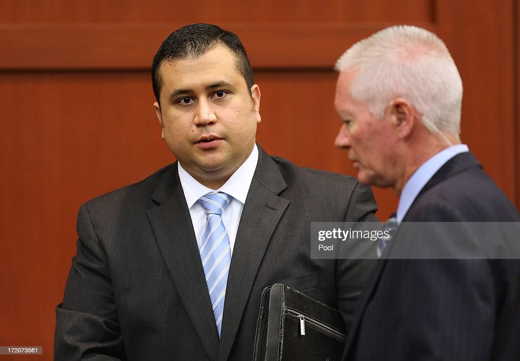 George Zimmerman is escorted by court personnel during a recess on the 16th day of his trial in Seminole circuit court July 1, 2013 in Sanford, Florida. Zimmerman is charged with second-degree murder for the February 2012 shooting death of 17-year-old Trayvon Martin.