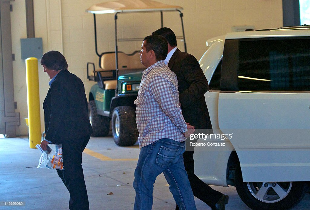 George Zimmerman is escorted by police as he returns to Seminole County Jail after having his bond revoked because of allegedly misleading the court...