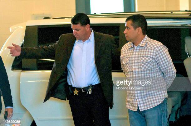 George Zimmerman is escorted out of a van in to the Seminole County Jail as he surrenders to authorities after he had his bond revoked because of...