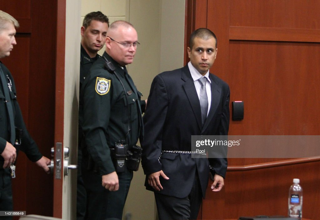 George Zimmerman (R) is lead into a Seminole County courtroom for his bond hearing on April 20, 2012 in Sanford, Florida. Trayvon Martin was shot by George Zimmerman, a member of a neighborhood watch in Sanford, Florida, who has been charged with second degree murder in the shooting. Bail was set at $150,000 for Zimmerman and he could be released from jail as early as April 21.