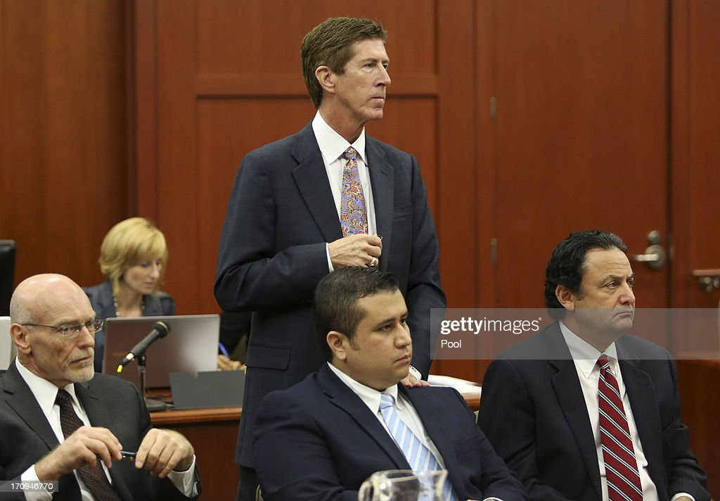 George Zimmerman is surrounded by his defense team, Don West (L), Mark O'Mara (C), and jury consultant Robert Hirschhorn during the final stages of jury selection for his trial in Seminole circuit court June 20, 2013 in Sanford, Florida. Zimmerman is charged with second-degree murder for the February 2012 shooting death of 17-year-old Trayvon Martin.