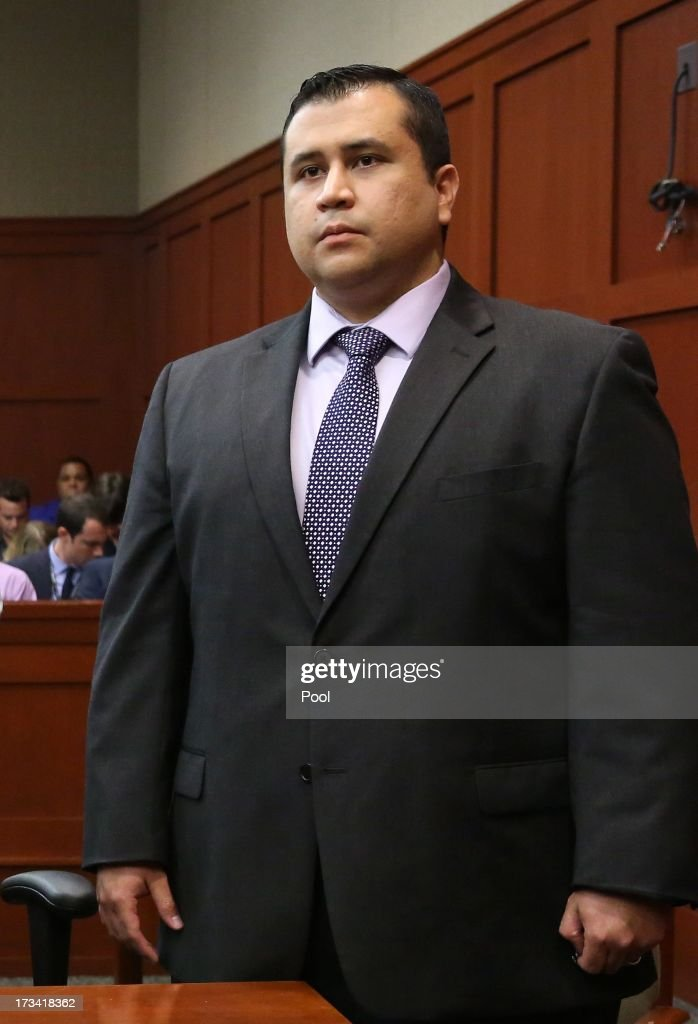 George Zimmerman listens as the verdict is announced that the jury finds him not guilty, on the 25th day of his trial at the Seminole County Criminal Justice Center July 13, 2013 in Sanford, Florida. Zimmerman was charged with second-degree murder in the 2012 shooting death of Trayvon Martin.