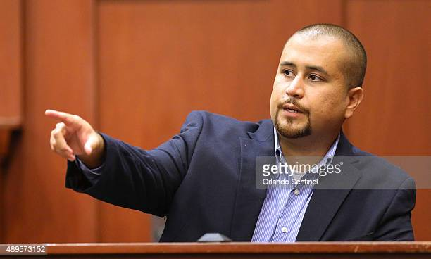 George Zimmerman points out the defendant as he testifies during a hearing for accused shooter Matthew Apperson on Tuesday Sept 22 at Seminole...