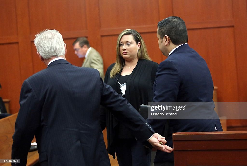 George Zimmerman, right, and his wife Shelly, center, exit the courtroom during a recess in the afternoon in Seminole circuit court on the fourth day of his trial, in Sanford, Florida, Thursday, June 13, 2013. Zimmerman is accused in the fatal shooting of Trayvon Martin.