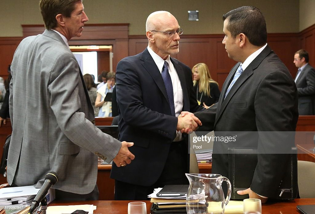 George Zimmerman shakes hands with defense attorney Don West, with Mark O'Mara (left), at the end of the 16th day of his trial in Seminole circuit court, July 1, 2013 in Sanford, Florida. Zimmerman is charged with second-degree murder for the February 2012 shooting death of 17-year-old Trayvon Martin.