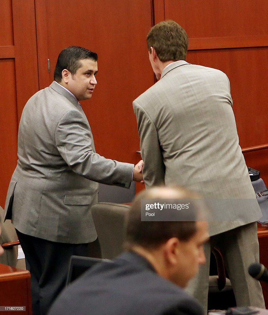 George Zimmerman shakes the hand of his defense attorney Mark O'Mara's hand at the start of day 14 during Zimmerman's murder trial in Seminole circuit court June 27, 2013 in Sanford, Florida. Zimmerman is charged with second-degree murder for the February 2012 shooting death of 17-year-old Trayvon Martin.