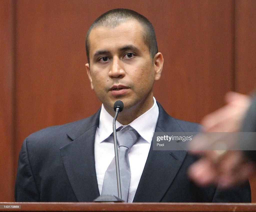 <a gi-track='captionPersonalityLinkClicked' href=/galleries/search?phrase=George+Zimmerman&family=editorial&specificpeople=9042868 ng-click='$event.stopPropagation()'>George Zimmerman</a> speaks towards Trayvon Martin's parents while apologizing for the shooting death of their son during his bond hearing in a Seminole County courtroom on April 20, 2012 in Sanford, Florida. Trayvon Martin was shot by <a gi-track='captionPersonalityLinkClicked' href=/galleries/search?phrase=George+Zimmerman&family=editorial&specificpeople=9042868 ng-click='$event.stopPropagation()'>George Zimmerman</a>, a member of a neighborhood watch in Sanford, Florida, who has been charged with second degree murder in the shooting. Bail was set at $150,000 for Zimmerman and he could be released from jail as early as April 21.