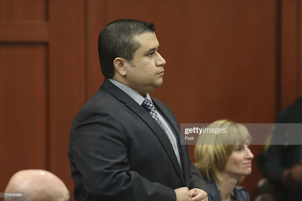 <a gi-track='captionPersonalityLinkClicked' href=/galleries/search?phrase=George+Zimmerman&family=editorial&specificpeople=9042868 ng-click='$event.stopPropagation()'>George Zimmerman</a> stands to identify himself Olivia Bertalan as she testifies on behalf of the defense during Zimmerman's murder trial during his murder trial in Seminole circuit court July 10, 2013 in Sanford, Florida. Zimmerman has been charged with second-degree murder for the 2012 shooting death of Trayvon Martin.
